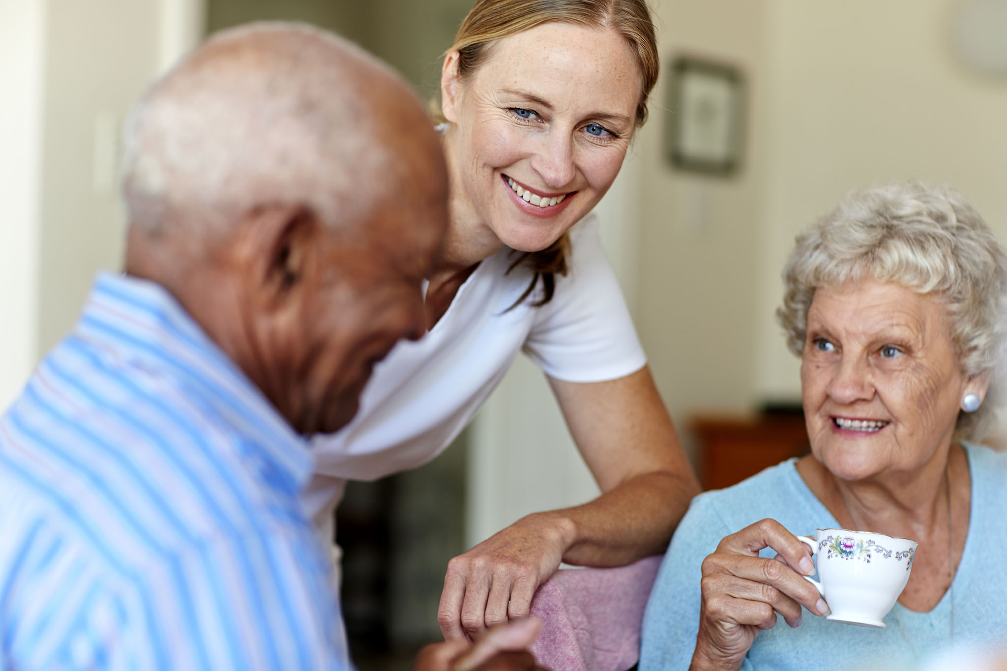 Eldery care business worker with residents